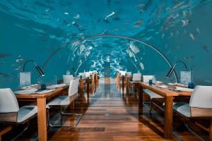 740b9555-150c-4a68-8e27-6f374f0104a4-h-conrad-maldives-rangali-island_f-and-b_ithaa-undersea-restaurant_hero_credit-justin-nicholas_hi-res-2